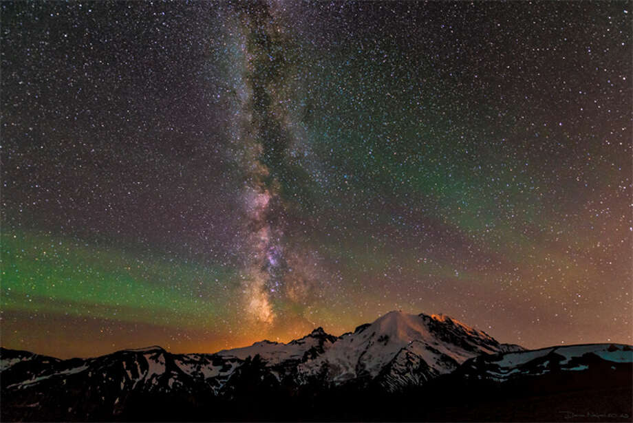 The Milky Way and the green tinge of airglow as seen on this photograph by Darren Neupert on July 12, 2013.