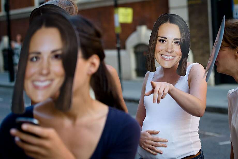 The baby will come when it's good and ready, ladies: Is that belly the real thing or a   Kate sympathy belly? (Outside St. Mary's Hospital in London.) Photo: Leon Neal, AFP/Getty Images