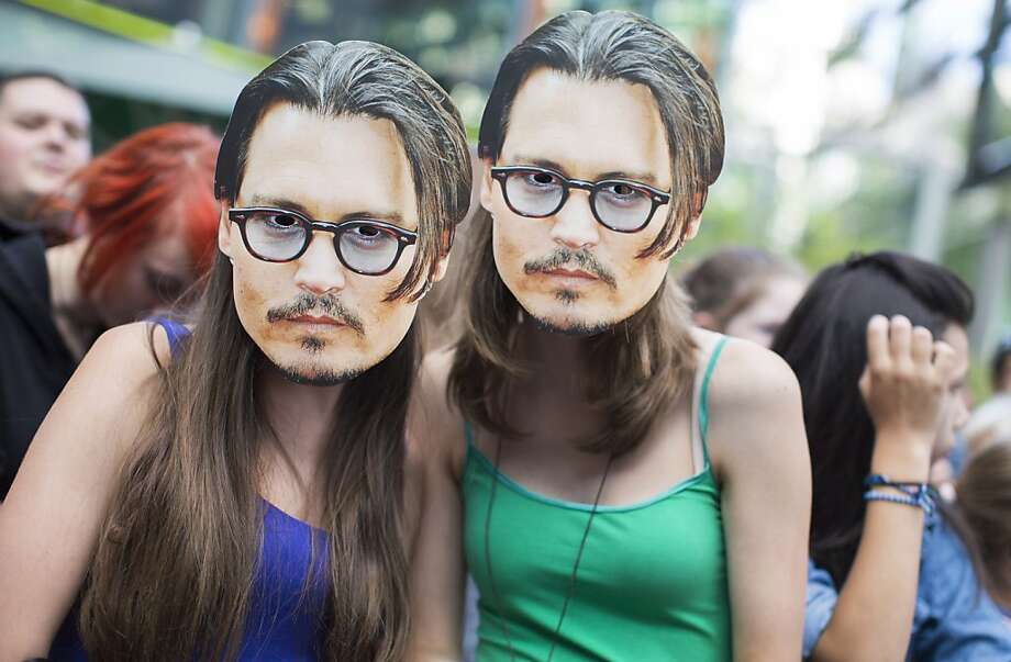 "Who were those masked girls? Johnny Depp fans wait to attend the German premiere of the  ""The Lone Ranger"" in Berlin. Photo: Gero Breloer, Associated Press"