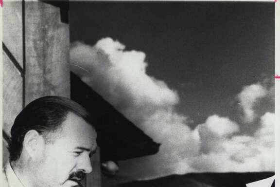 Ernest Hemingway at his typewriter.
