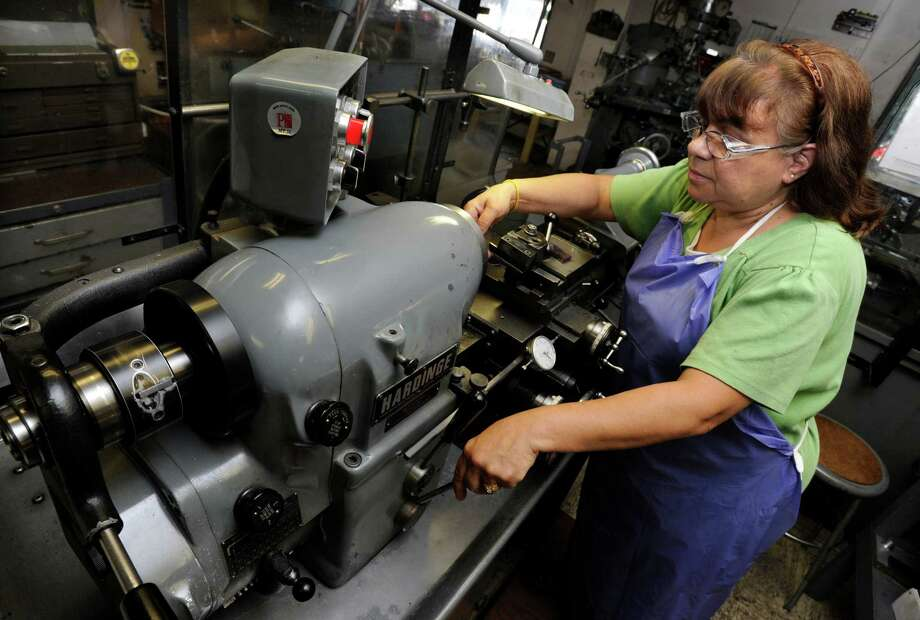 Maria Evansco, 57, of New Milford,  a machinist with PMC Engineering in Danbury, Conn., works on parts for pressure sensors, Thursday, July 18, 2013. Photo: Carol Kaliff / The News-Times