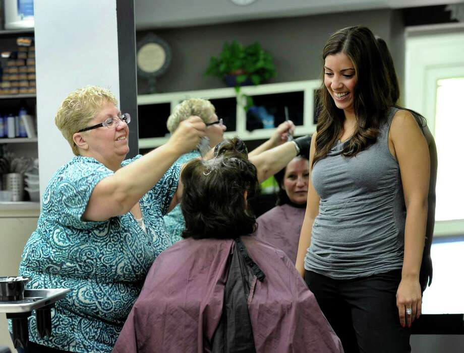 Nancy Fairchild, 57, left and Megan Heck, 26, owners of Manely You Hair Salon in Danbury, Conn., chat with client Dawn Pickerill of Brookfield, Tuesday, July 16, 2013. Photo: Carol Kaliff / The News-Times