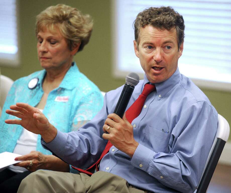 Sen. Rand Paul, R-Ky., takes questions from tea party members at the Logsdon Community Center in Owensboro, Ky. His support for a controversial staffer highlights his status outside the mainstream of Republican politics. Photo: Associated Press