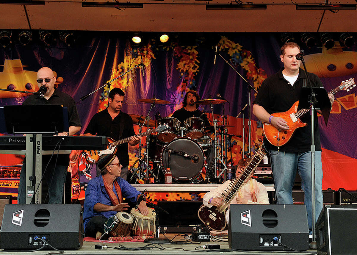 Musicians perform at last year's Beatles festival, Danbury Fields Forever, at Ives Concert Park in Danbury. Look closely and you'll see some yellow submarines on the backdrop. This year's festival, Saturday, Aug. 3, features 10 bands, food, vendors, bouncy attractions for kids to play on, and more.
