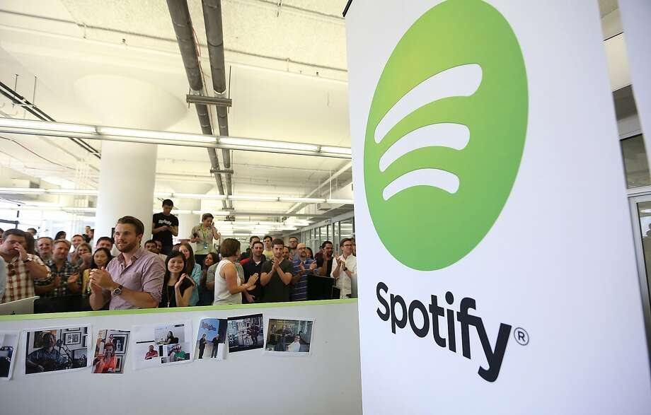 NEW YORK, NY - JUNE 27:  People gather in Spotify offices following a press conference on June 27, 2013 in New York City. Spotify will add 130 tech and engineering jobs in New York and expand to a new office in the Chelsea neighborhood of Manhattan.  (Photo by Mario Tama/Getty Images) Photo: Mario Tama, Getty Images