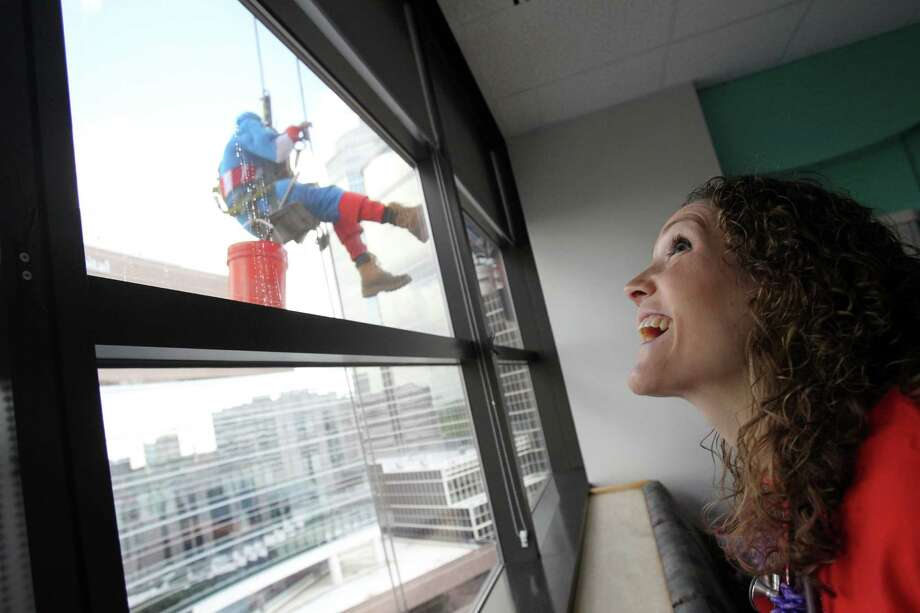 Starley Buchanan, R.N., is one of the staff members excited to see window washers dressed as Superman, Spiderman, Batman, and Captain America to surprise patients at Texas Children's Hospital on Friday, July 19, 2013, in Houston. Photo: Mayra Beltran / © 2013 Houston Chronicle
