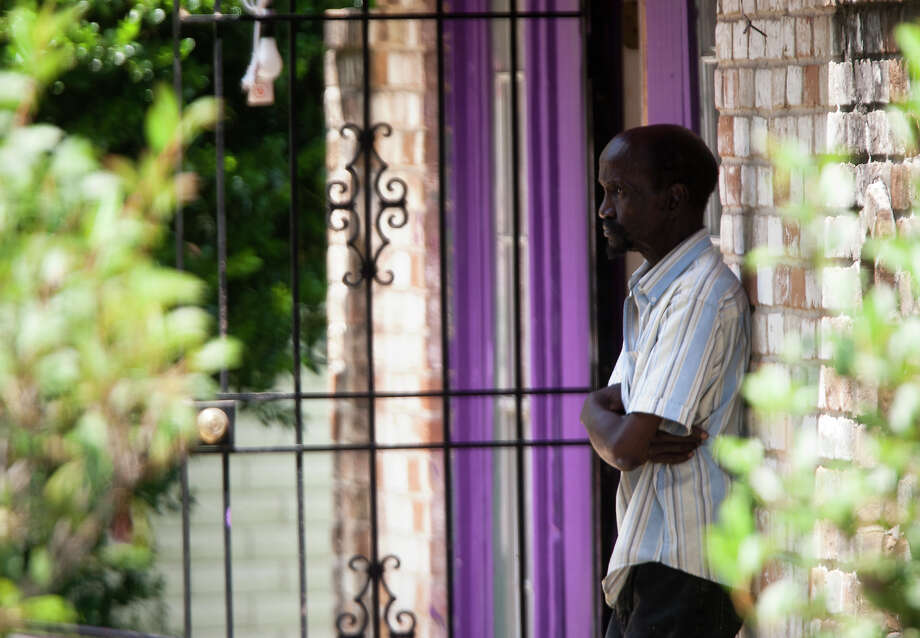 "A man waits as police investigate a scene where four individuals were held captive in the 8600 block of White Castle in Houston, Friday, July 19, 2013, in Houston. Police found four men held against their will in the home in deplorable conditions after they responded to a 911 call that brought police to a north Houston home described as a ""dungeon"". Photo: Cody Duty, Houston Chronicle / © 2013 Houston Chronicle"