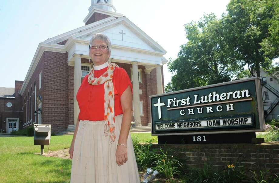 Pastor Allie Leitzel stands outside the First Lutheran Church of Albany on Tuesday, July 16, 2013 in Albany, N.Y. (Lori Van Buren / Times Union) Photo: Lori Van Buren / 00023185A