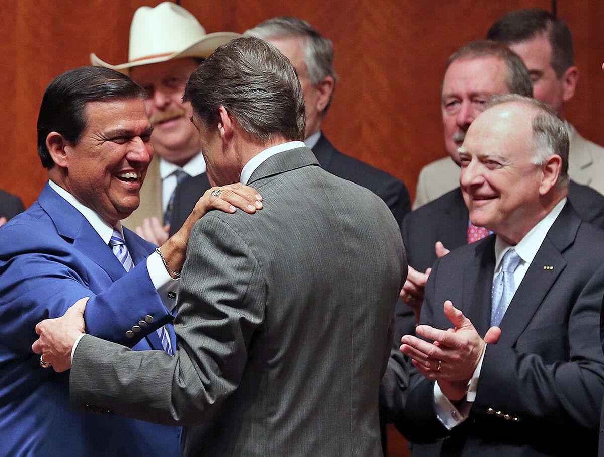 Again wearing his blue coat, Senator Eddie Lucio D-Brownsville, greets Governor Rick Perry before the signing into law of the abortions restrictions bill on July 18, 2013.