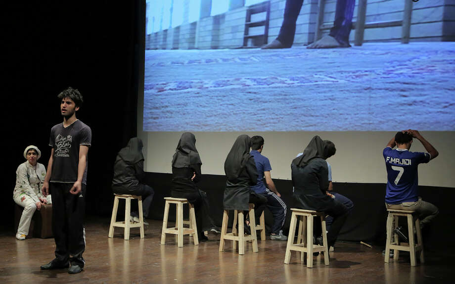 """Iranian actors perform in """"The Blue Feeling of Death'' in Tehran, Iran. The production showcases activist art against Iran's legal codes that allow death sentences for children. Photo: Hadi Shabani, STR / AP"""