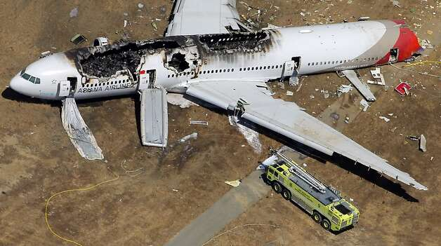 The destroyed fuselage of Asiana Airlines Flight 214 is visible on the runway at San Francisco International Airport after it crashed on landing and burned on Saturday, July 6, 2013. Photo: Carlos Avila Gonzalez, The Chronicle