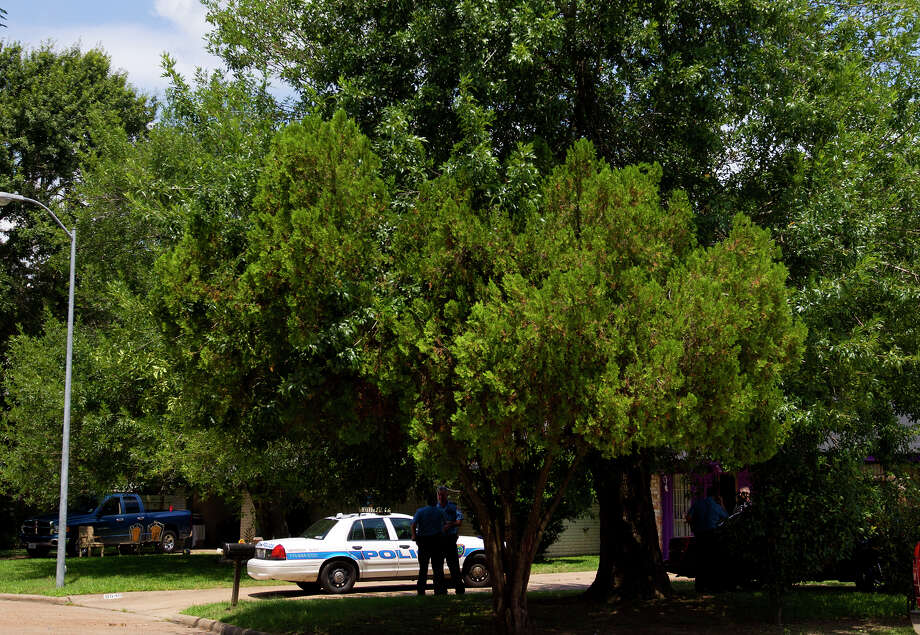 "Police investigate a scene where four individuals were held captive in the 8600 block of White Castle in Houston, Friday, July 19, 2013, in Houston. Police found four men held against their will in the home in deplorable conditions after they responded to a 911 call that brought police to a north Houston home described as a ""dungeon"". Photo: Cody Duty, Houston Chronicle / © 2013 Houston Chronicle"