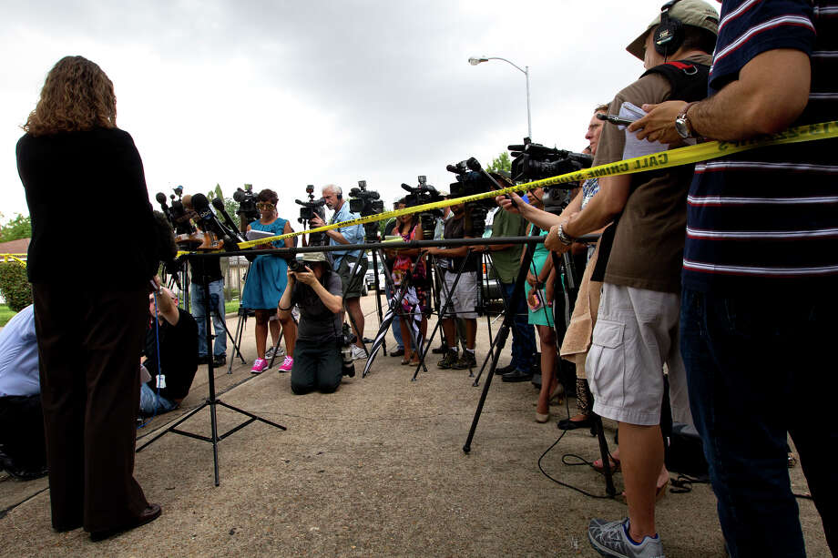 "HPD spokesperson Jodi Silva answers questions regarding the involvement of a scene where four individuals were held captive in the 8600 block of White Castle in Houston, Friday, July 19, 2013, in Houston. Police found four men held against their will in the home in deplorable conditions after they responded to a 911 call that brought police to a north Houston home described as a ""dungeon"". Photo: Cody Duty, Houston Chronicle / © 2013 Houston Chronicle"
