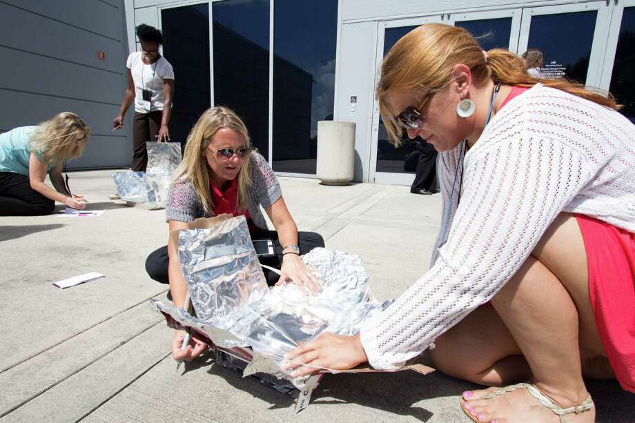 Lynn Dotson of NASA works with Stamford schools teacher Ljiljana Djinovic as part of a GE Foundation grant that funded a trip to the Kennedy Space Center for seven teachers. Photo: Contributed Photo