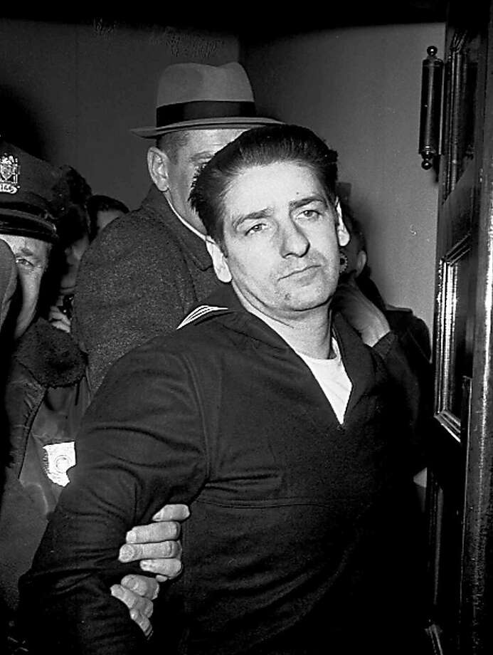 FILE - In this Feb. 25, 1967 file photo self-confessed Boston Strangler Albert DeSalvo is seen minutes after his capture in Boston. Authorities say DNA tests on the remains of DeSalvo confirm he killed Mary Sullivan, the woman believed to be the serial killer's last victim. DeSalvo admitted to killing Sullivan and 10 other women in the Boston area between 1962 and 1964 but later recanted. He was later killed in prison. (AP Photo, File) Photo: Uncredited, Associated Press