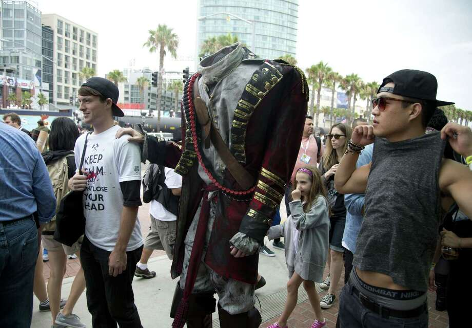 A person dressed as a headless man arrive at the Comic-Con International 2013 at the San Diego Convention Center  in San Diego, California, on July 19, 2013. Comic-Con is a four-day geekfest of pop culture attended by some 130,000 devotees of comic books, movies and TV shows -- many dressed up in the costumes of their idols. Photo: ROBYN BECK, AFP/Getty Images / AFP