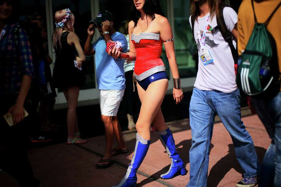 A woman dressed as Wonder Woman attends Comic Con at the San Diego Convention Center on July 19, 2013 in San Diego, California.  Comic Con International Convention is the world's largest comic and entertainment event and hosts celebrity movie panels, a trade floor with comic book, science fiction and action film-related booths, as well as artist workshops and movie premieres. Photo: Sandy Huffaker, Getty Images / 2013 Getty Images