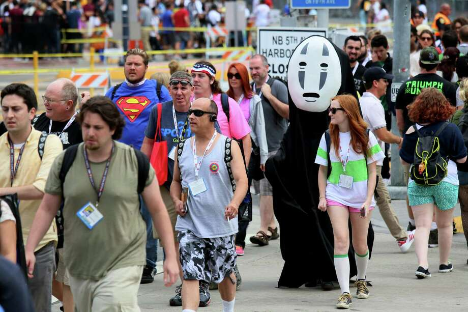 Comic fans cross the street enroute to Comic Con on July 19, 2013 in San Diego, California.  Comic Con International Convention is the world's largest comic and entertainment event and hosts celebrity movie panels, a trade floor with comic book, science fiction and action film-related booths, as well as artist workshops and movie premieres. Photo: Sandy Huffaker, Getty Images / 2013 Getty Images