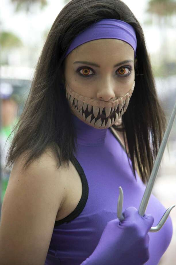 Attendee Jacqueline Barker portrays the character Mileenathe from the Mortal Kombat series of fighting video games., at the Comic-Con International 2013 at the San Diego Convention Center  in San Diego California July 19, 2013.   Comic-Con is a four-day geekfest of pop culture attended by some 130,000 devotees of comic books, movies and TV shows -- many dressed up in the costumes of their idols. Photo: ROBYN BECK, AFP/Getty Images / AFP