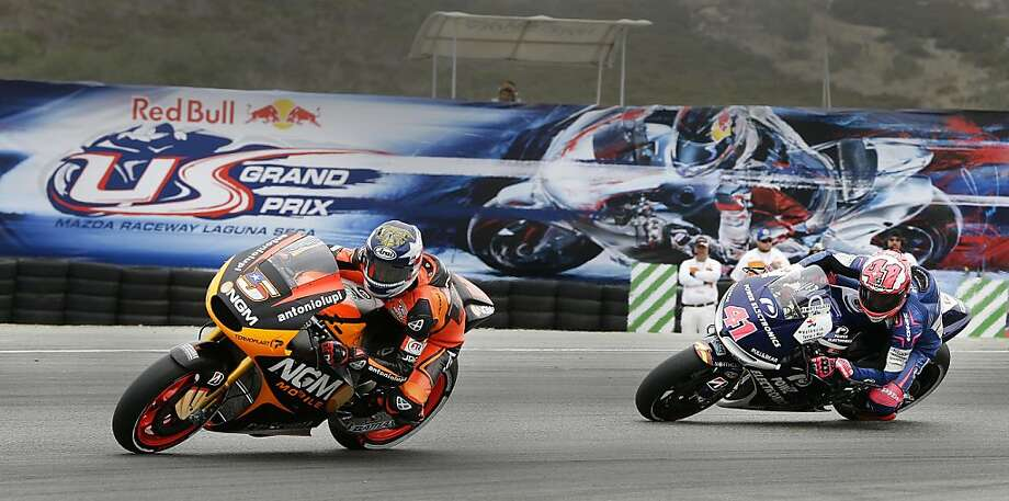 American Colin Edwards (left) leads Aleix Espargaro of Spain through a turn at Laguna Seca Raceway in Monterey on Friday during practice ahead of Sunday's MotoGP world championship series event. Marc Marquez of Spain, who holds a two-point edge over countryman Dani Pedrosa atop the series standings, has finished in the top three in all but one race. Qualifying is at 2 p.m. Saturday. Photo: Ben Margot, Associated Press