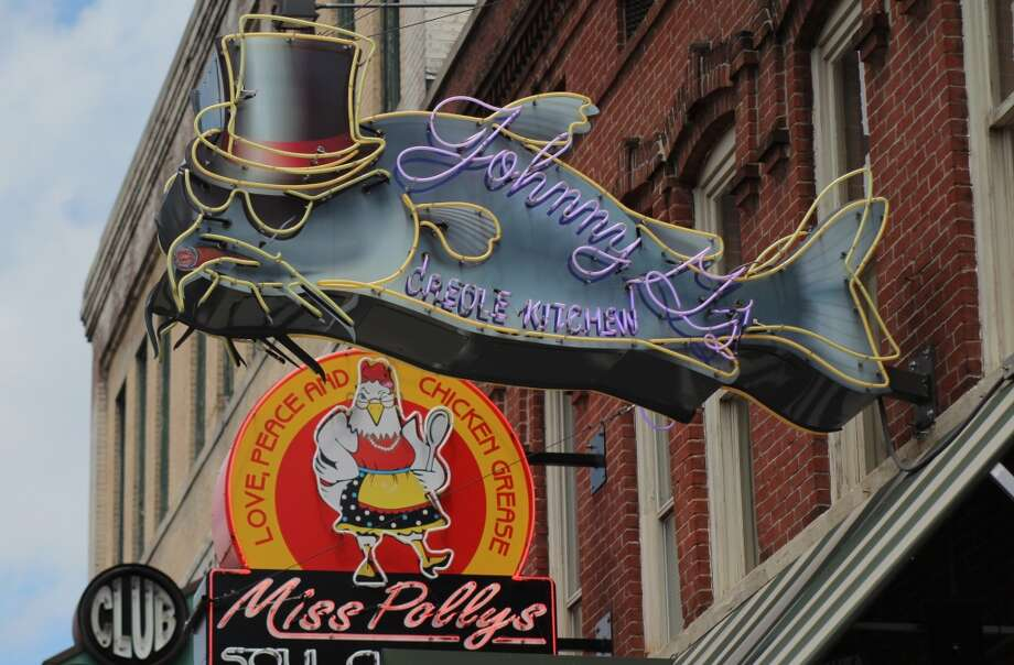 "What's better than a catfish with a top hat? The slogan: ""Love, Peace and Chicken Grease"""