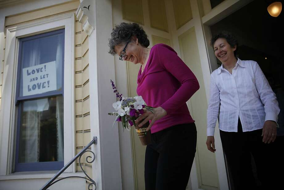 Karen Strauss (left) and Ruth Borenstein leave their San Francisco home for their wedding at City Hall on Friday. Photo: Lea Suzuki, The Chronicle