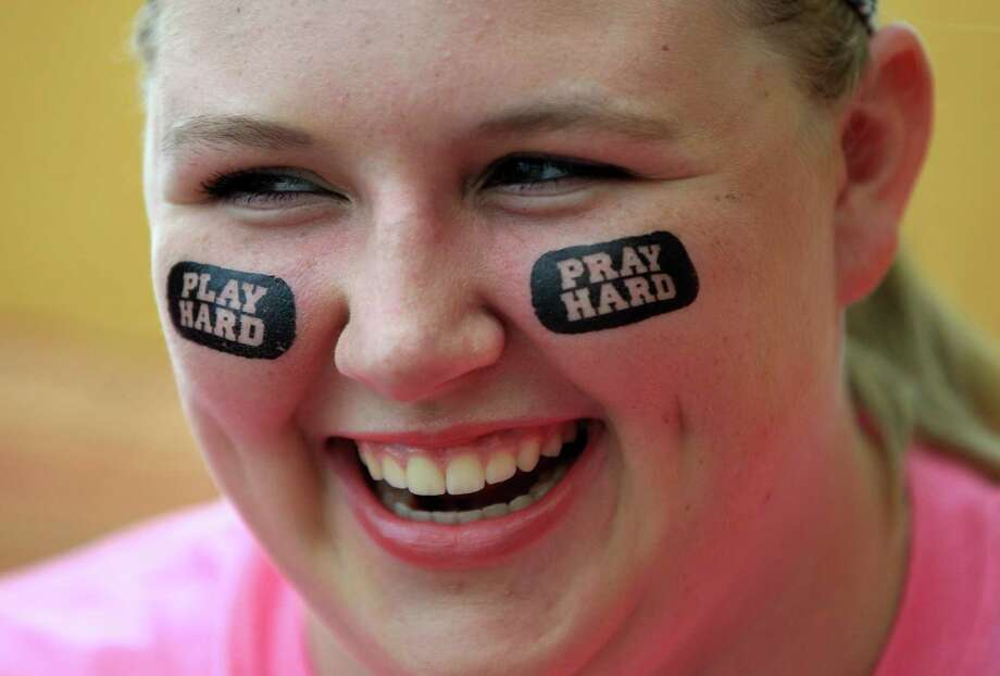 "Amelia Boettiger, 16, wears eyeblack that reads ""Play Hard. Pray Hard."" as she and her group from San Angela Marici in Missouri City prepare for the start of this weekend's Archdiocese of Galveston-Houston's Archdiocesan Youth Conference (AYC) at the Hilton-Americas Hotel, Friday, July 19, 2013, in Houston. Photo: Karen Warren, Houston Chronicle / © 2013 Houston Chronicle"