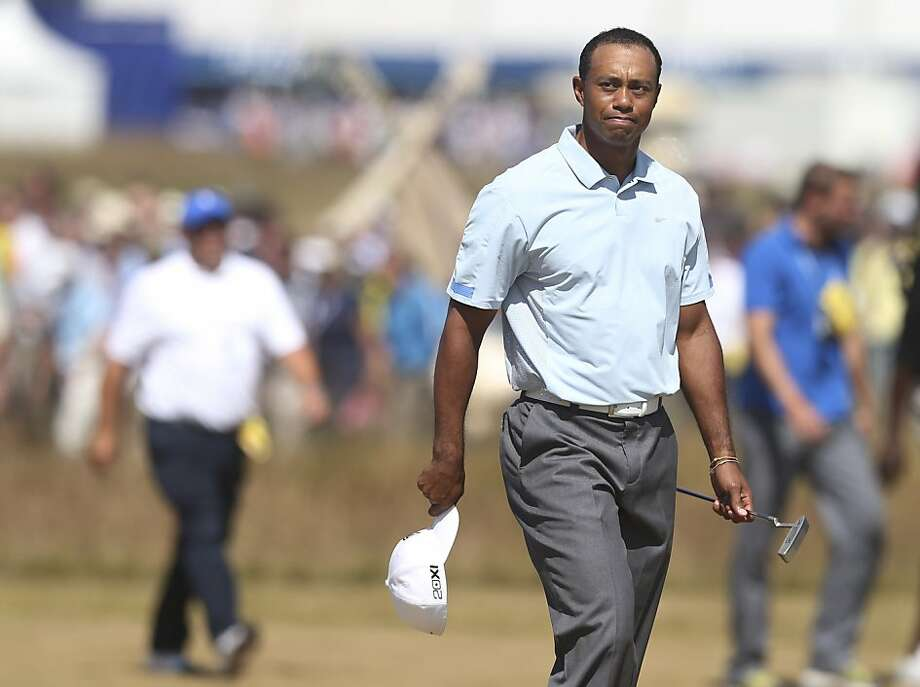 Tiger Woods of the United States walks onto the 18th green during the second round of the British Open Golf Championship at Muirfield, Scotland, Friday July 19, 2013. (AP Photo/Scott Heppell) Photo: Scott Heppell, Associated Press