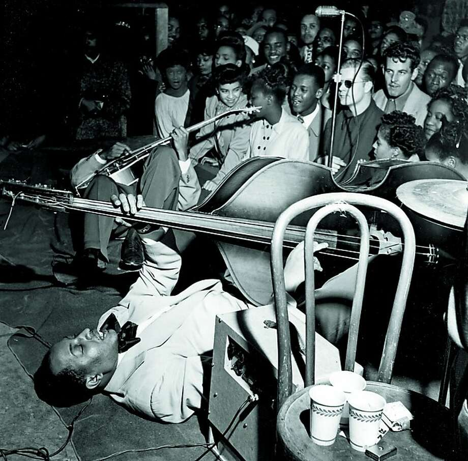 Renowned San Francisco musician Vernon Alley takes his bass down low in this mid-20th century photo by David Johnson. Photo: David Johnson