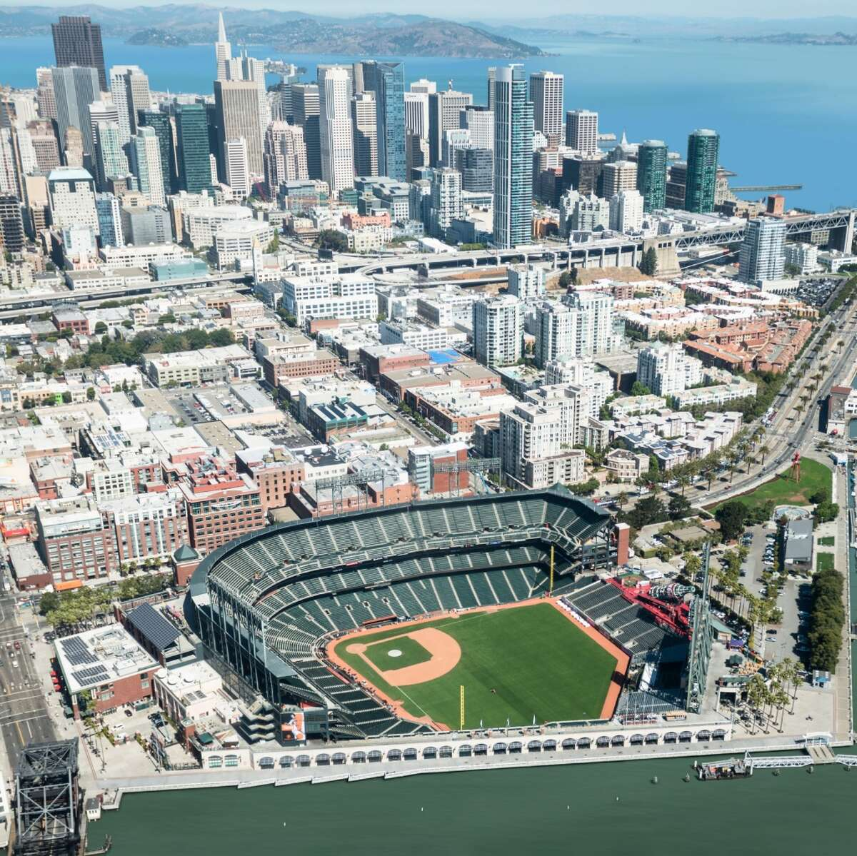 Nickolay Lamm , from self-storage search engine created these illustrations of sea level rise at AT&T Park in San Francisco.