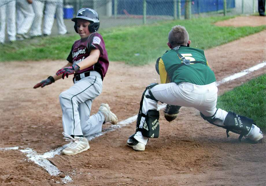 Stamford National's Joey Skarad scores a run during Friday's Little League Game against Edgewood at Bill Terry Field in Wilton, Conn., on July 19, 2013. Photo: Lindsay Perry / Stamford Advocate