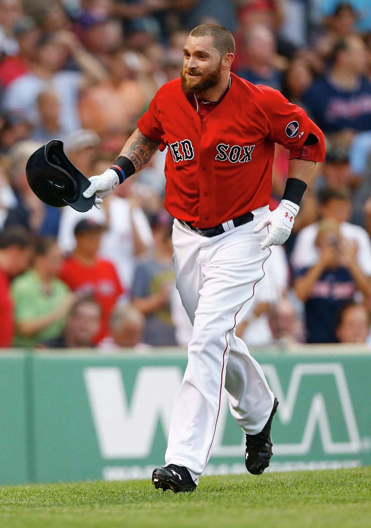 BOSTON, MA - JULY 19: Jonny Gomes #5 of the Boston Red Sox celebrates after hitting a two-run home run in the second inning off of Andy Pettitte #46 of the New York Yankees during the game on July 19, 2013 at Fenway Park in Boston, Massachusetts.