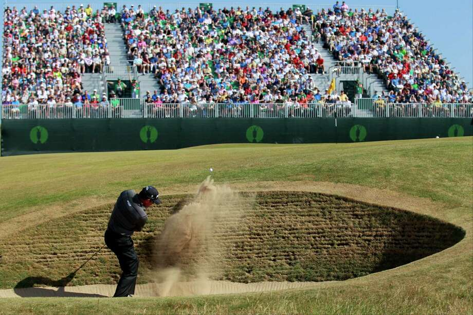 Lee Westwood, here blasting out of a bunker on the fourth hole Friday, has turned his shaky short-game skills into a strength of late, resulting in a strong showing at Muirfield where he's tied for second place. Photo: Peter Morrison, STR / AP