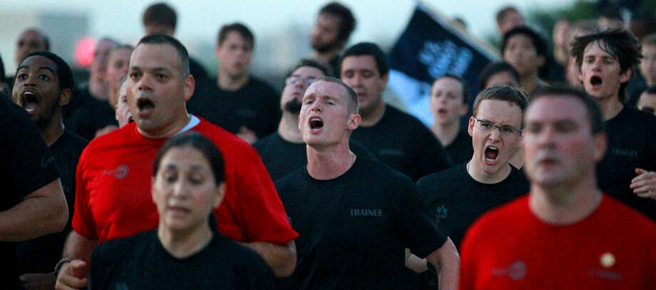 "Employees and others taking part in USAA's ""Zero Day PT"" event run in formation on the company's San Antonio campus. Photo: John Davenport / San Antonio Express-News"
