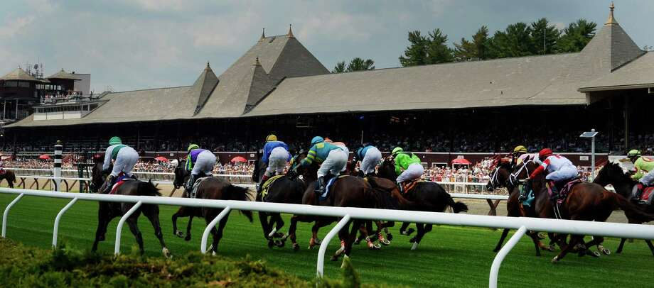 The 150 race meeting kicks off at the first race on the card breaks from the gate on opening day July 19, 2013, at the Saratoga Race Course in Saratoga Springs, N.Y.   (Skip Dickstein/Times Union) Photo: SKIP DICKSTEIN / 10023140A