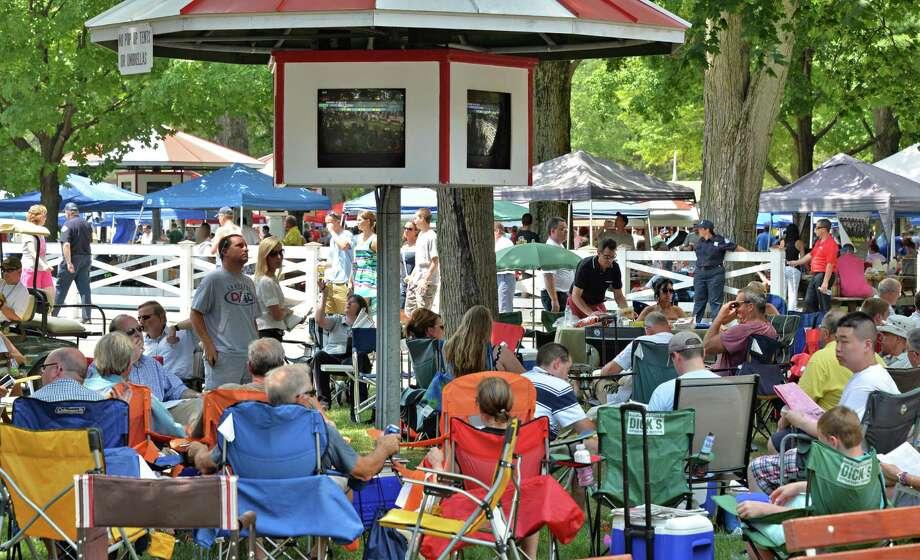 "Picnicers set up on the ""back yard"" on opening day at Saratoga Race Course Saratoga Springs, NY, Friday July 19, 2013.  (John Carl D'Annibale / Times Union) Photo: John Carl D'Annibale / 10023139A"