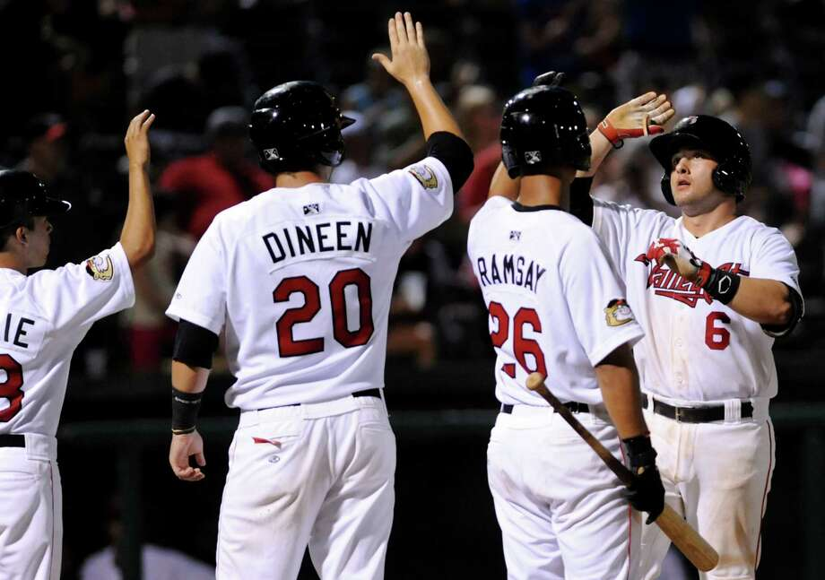 ValleyCats Jake Rodriguez, right, celebrates his home run with teammates during their baseball game against the Auburn Doubledays on Friday, July 19, 2013, at Bruno Stadium in Troy, N.Y. (Cindy Schultz / Times Union) Photo: Cindy Schultz / 00023163A