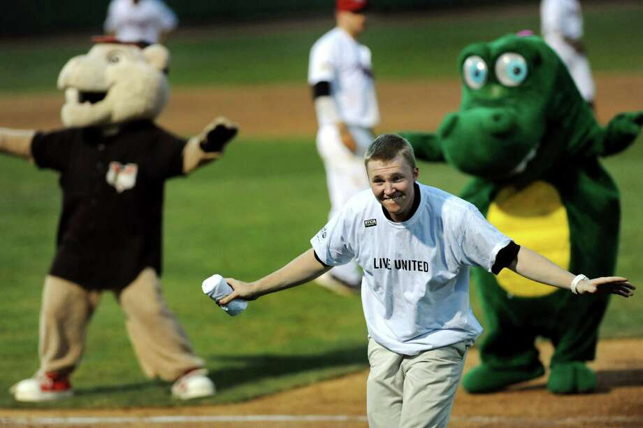 ValleyCats employee Ian Rebhan, center, dances with mascots Southpaw, left, and Zoggy during a changeup in their baseball game against the Auburn Doubledays on Friday, July 19, 2013, at Bruno Stadium in Troy, N.Y. (Cindy Schultz / Times Union) Photo: Cindy Schultz / 00023163A