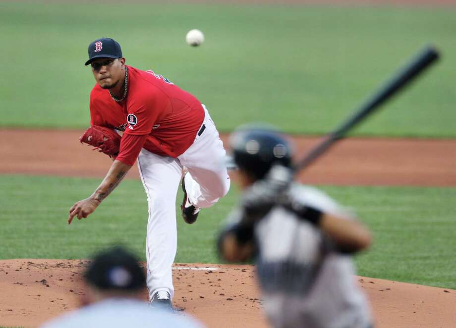 Boston Red Sox starting pitcher Felix Doubront delivers against the New York Yankees during the first inning of a baseball game at Fenway Park, Friday, July 19, 2013, in Boston. (AP Photo/Charles Krupa) ORG XMIT: MACK106 Photo: Charles Krupa / AP