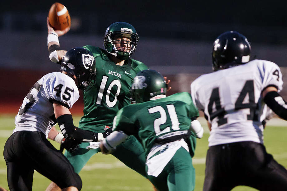 Steele's Ross Luensmann (left) and Josh Malin close in on Reagan quarterback Trevor Knight as he gets off a pass during their Class 5A Division II quarterfinal playoff game at Heroes Stadium on Dec. 3, 2011. Steele advanced to the next round with a 35-10 victory over the Rattlers. Photo by Marvin Pfeiffer Photo: MARVIN PFEIFFER, PRIME TIME NEWSPAPERS / Prime Time Newspapers 2011