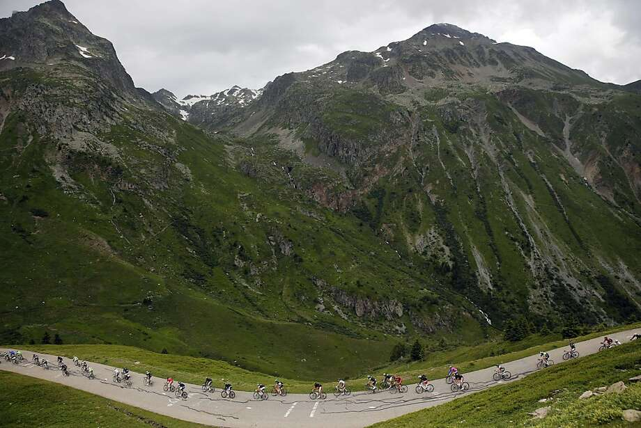 The pack rides during the 204.5 km nineteenth stage of the 100th edition of the Tour de France cycling race on July 19, 2013 between Bourg-d'Oisans and Le Grand-Bornand, French Alps. AFP PHOTO / JEFF PACHOUDJEFF PACHOUD/AFP/Getty Images Photo: Jeff Pachoud, AFP/Getty Images
