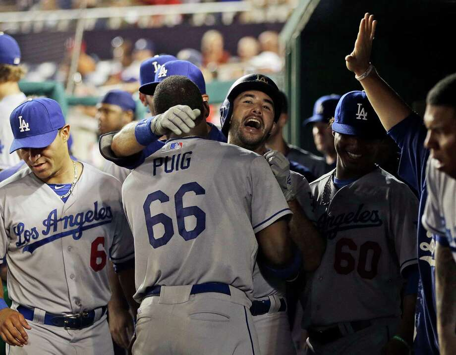 Usually the center of attention, Yasiel Puig (66) deferred to teammate Andre Ethier late in Friday's game. Photo: Pablo Martinez Monsivais, STF / AP