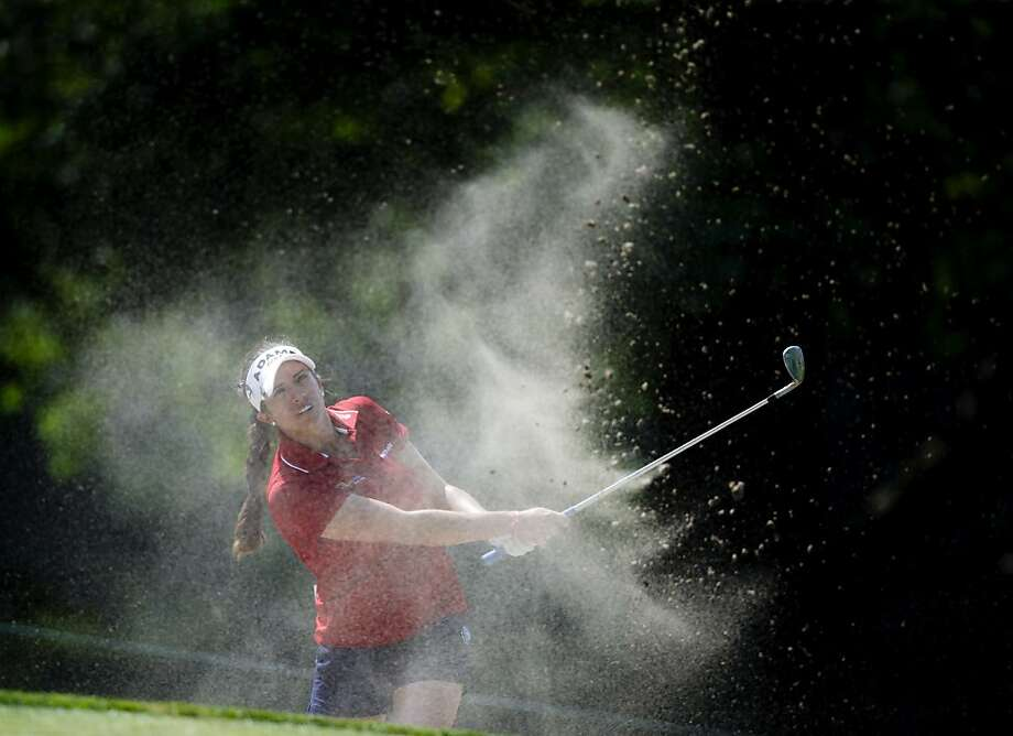 Gerina Piller hits from a bunker next to the first green during the second round of the Marathon Classic LPGA golf tournament at Highland Meadows Golf Club in Sylvania, Ohio, Friday, July 19, 2013. (AP Photo/Rick Osentoski) Photo: Rick Osentoski, Associated Press