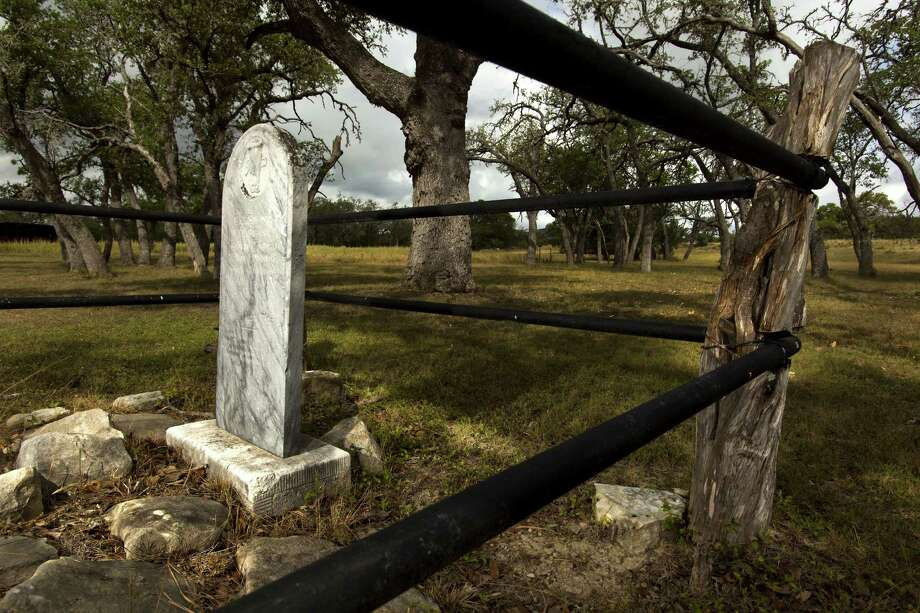 A headstone was added at the Hanging Tree grave around 1900 and fencing was put in about 1950. When Phil Watkins purchased the property that includes the burial site in 1981, it was overgrown with weeds. Photo: Photos By William Luther / San Antonio Express-News