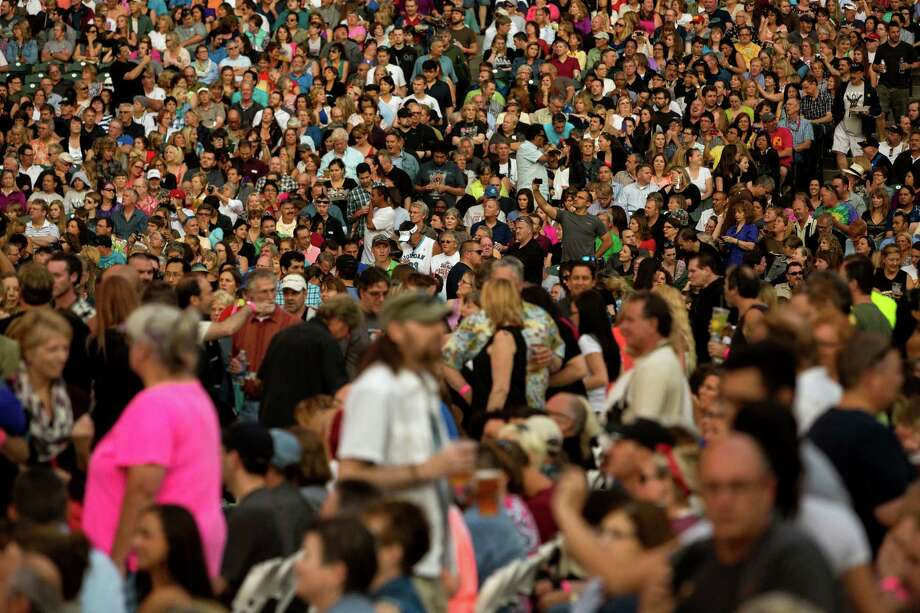 "Fans await Sir Paul McCartney's  ""Out There"" Tour Friday, July 19, 2013, at Safeco Field in Seattle. The show marked the first public concert at Safeco Field since the stadium opened in 1999. Photo: JORDAN STEAD, SEATTLEPI.COM / SEATTLEPI.COM"