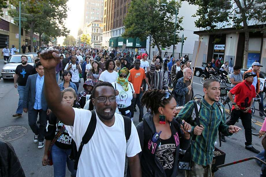 Several hundred people protested the verdict in the George Zimmerman trial as they chanted slogans while walking from Frank Ogawa Plaza to the Fruitvale BART station. Photo: Lance Iversen, The Chronicle