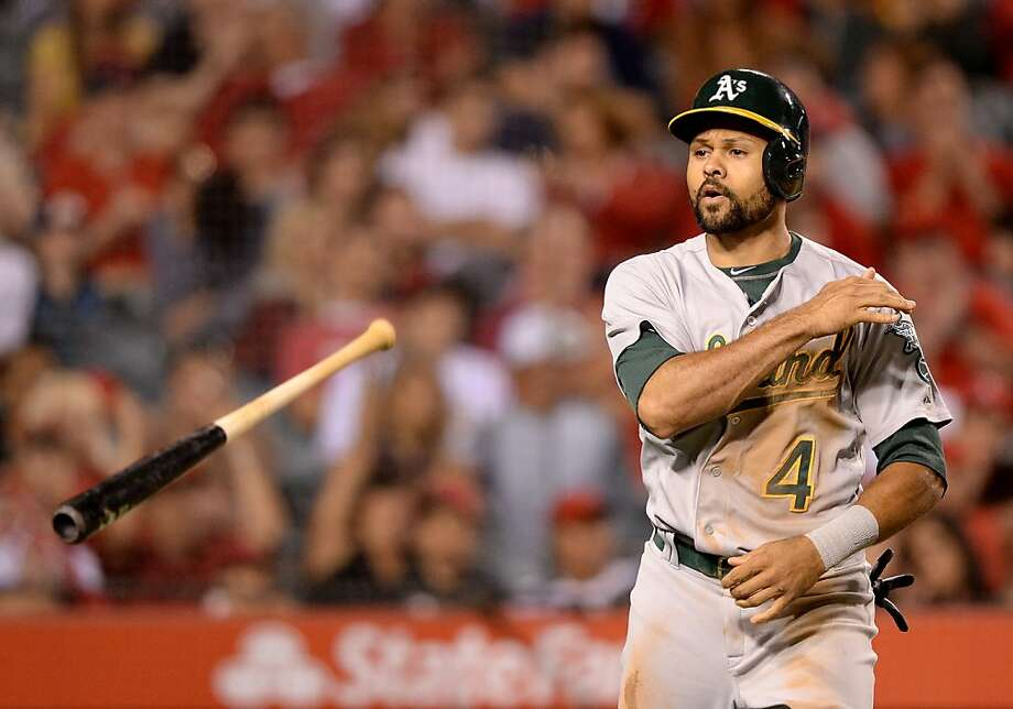 ANAHEIM, CA - JULY 19:  Coco Crisp #4 of the Oakland Athletics reacts to his strikeout to end the seventh inning against the Los Angeles Angels at Angel Stadium of Anaheim on July 19, 2013 in Anaheim, California.  (Photo by Harry How/Getty Images) Photo: Harry How, Getty Images