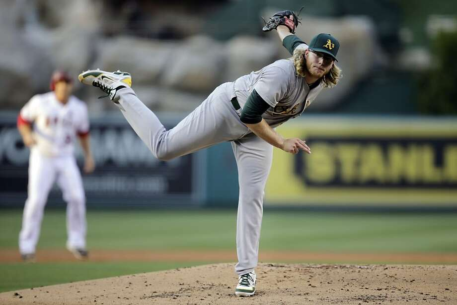 Oakland Athletics starting pitcher A.J. Griffin throws against the Los Angeles Angels during the first inning of a baseball game on Friday, July 19, 2013, in Anaheim, Calif. (AP Photo/Jae C. Hong) Photo: Jae C. Hong, Associated Press