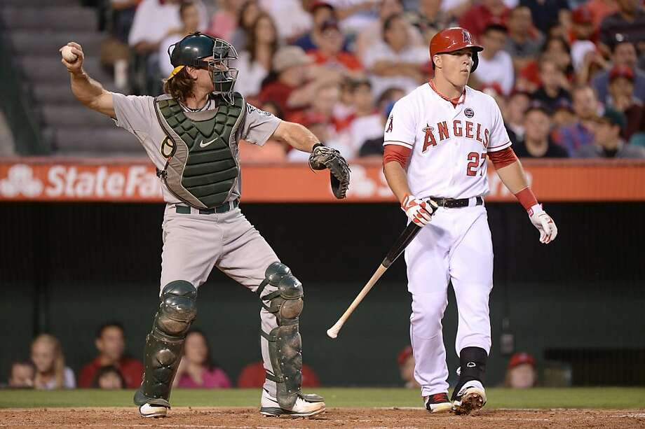 ANAHEIM, CA - JULY 19:  Mike Trout #27 of the Los Angeles Angels reacts to his strikeout in front of John Jaso #5 of the Oakland Athletics during the third inning at Angel Stadium of Anaheim on July 19, 2013 in Anaheim, California.  (Photo by Harry How/Getty Images) Photo: Harry How, Getty Images
