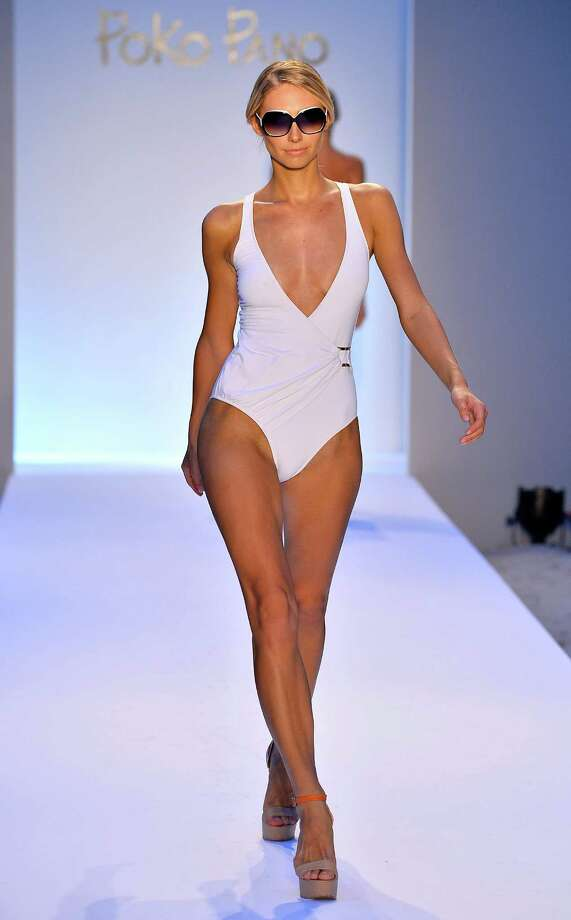 A model walks the runway at the Poko Pano  show. Photo: Frazer Harrison, Getty Images For Mercedes-Benz Fashion Week Swim 2014  / 2013 Getty Images